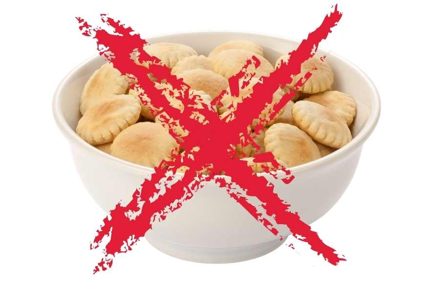 a bowl of crackers crossed out with a red cross