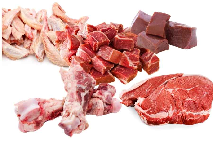 A variety of meats in front of a white background