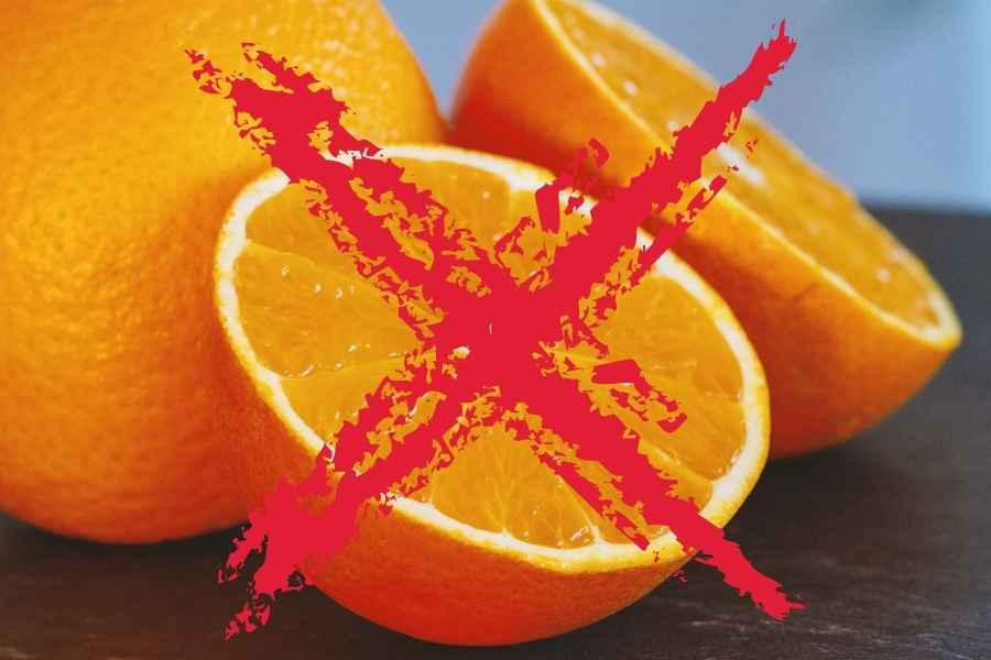 Oranges on a dark surface cossed out