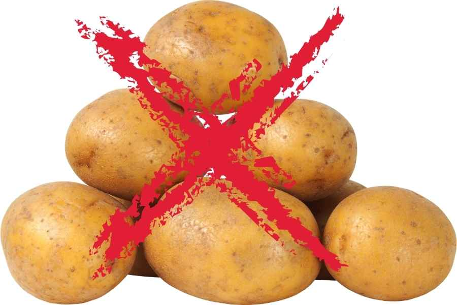potatoes on a white background crossed out with a red cross