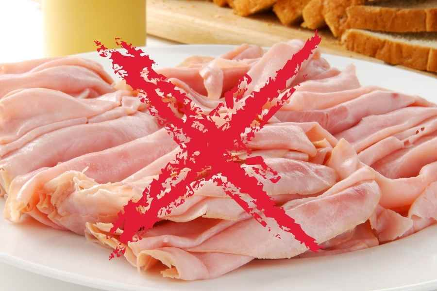 turkey lunch meat on a white backgrund cossed out